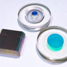 Moated ring laser gyro mirrors