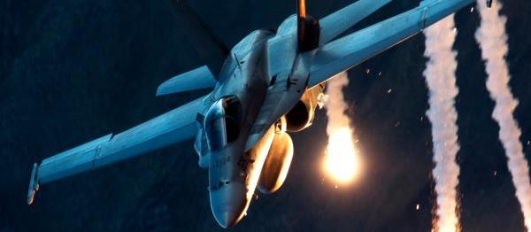 McDonnell Douglas F/A-18 Hornet deploys flares for missile defense and evasion